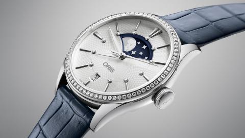 Oris Artelier Grande Lune, Date Diamonds – новое пополнение классической коллекции Oris Artelier. Ободок корпуса часов украшен 72 бриллиантами, циферблат – 11 бриллиантовыми маркерами